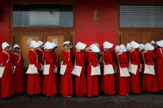 Women dressed as handmaids promoting television series The Handmaid's Tale during the SXSW Music Film Interactive Festival, Austin, Texas.