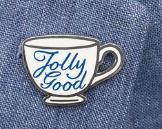 That's a jolly good cup of tea! This hard enamel pin is 27 mm inch) wide with blue lettering printed on the white enamel. ☕️ Check out all the pins in the Coffee / Tea collection. British Gifts, Cool Pins, Best Tea, Hard Enamel Pin, White Enamel, Tea Cups, Unique Jewelry, Prints, Accessories