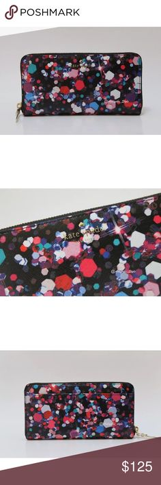 """kate spade new york  lacey grant lane wallet kate spade new york  lacey grant lane wallet / clutch 100% Authentic New with tag  Color: Jewel multi Style: PWRU5241 Retail: $178.00  kate spade new york imbues a perfectly practical, zip around wallet with a playful sensibility, courtesy of a colorful paint splatter print. Zip closure; lined Exterior slip pocket, interior zip pocket, five interior slip pockets 7.75""""W x 1""""D x 4.5""""H Polyurethane Imported kate spade Bags Wallets"""
