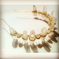 This amazing headpiece is adorned with authentic clear quartz crystal points hand wrapped in gold and sits like an angelic crown. Raw and elegant it's a wow piece.   Handmade
