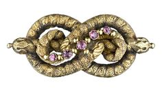 Georgian Lover's Knot with Closed Back Set Garnets, c. 1800.  Photo Courtesy of Lang Antiques.