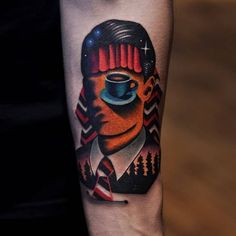 Tattoo of Agent Cooper from Twin Peaks on the inner forearm.