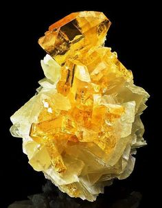 Golden Barite perched atop Calcite crystals -- From the Meikle Mine, Bootstrap District, Elko County, Nevada.