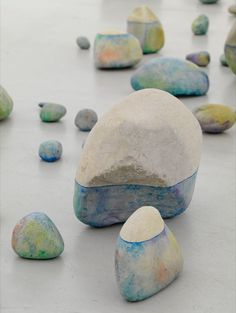 Experiment with water-colour + acrylic wash on stones   (or buy+ see more by artist Lionel Esteve)