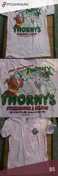 🐦Thorny's Saloon Keepsake Tee🐦🐦 Powder pink short sleeve Thorny's Steakhouse and Saloon tee with logo on front breast and on back mascot cartoon and Me Sooooo Thorny/ Thorny's Myrtle Beach South Carolina.  Size small. Gently loved. Tee by Gildan Ultra Cotton. Size small. Participating item in the sale see banner for details Thorny's Saloon Tops Tees - Short Sleeve