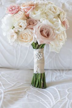 ivory pink blush wedding bouquet finished with ivory satin bow. Designed by Rachel A. Clingen.