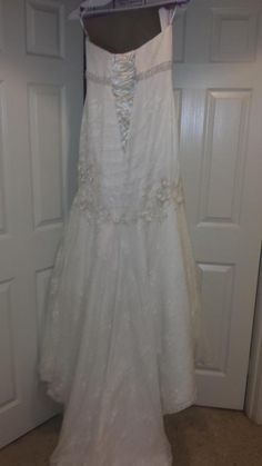Oleg Cassini: buy this dress for a fraction of the salon price on PreOwnedWeddingDresses.com