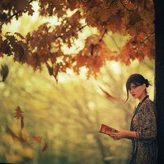 reading under a tree