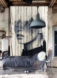 industrial loft bedroom with great wall art backdrop