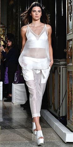 Kim and Kendall Are the Champions of Fashion Month | KENDALL JENNER  | At first we didn't realize Kendall was on the runway, because this sheer top look is one of her go-to outfits in reality. That's probably why she looks extra comfortable hitting the catwalk at the Ports 1961 show.