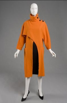 Philadelphia Museum Woman's Coat  Made in Japan, Asia c. 1980s - early 1990s  Designed by Yohji Yamamoto, Japanese, born 1943  Orange wool flannel twill Length: 44 1/2 inches (113 cm)  Currently not on view  2009-175-1  Gift of Judith E. Stein, 2009