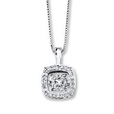 Twinkling round diamonds frame the dancing centerpiece of this Diamonds in Rhythm™ necklace. Always in motion, catching light from every angle, the pendant, with a total diamond weight of 1/3 carat, sways from an 18-inch box chain that is secured with a lobster clasp. Diamond Total Carat Weight may range from .29 - .36 carats.