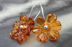 Flower earrings (amber) by Isla Osborne. Lampworked glass, silver. NZ$40 from Etsy.