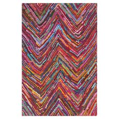 Add a vibrant touch to neutral decor with this hand-tufted cotton rug, showcasing a multicolor chevron motif.   Product: Rug