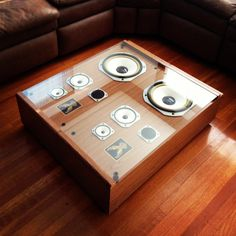 """I was getting ready to load these floor speakers in the car and take them to Goodwill, when I realized how cool the design below the covers was. Since I had been looking for a coffee table for a while, I immediately saw the potential here. All it took what a 1/4"""" sheet of glass cut to fit, and you can see the results for yourself in the picture. =)"""
