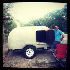 Proud builder and his homemade tear drop camper