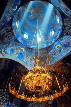 The beautiful ceiling and dome of a Greek Orthodox Church.