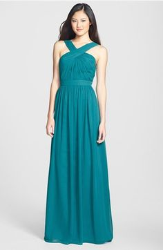 Teal bridesmaid dress by ML Monique Lhuillier, long flowy chiffon teal gown with criss-cross neckline
