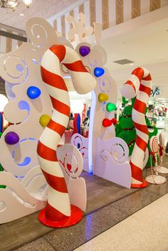 Larger-than-life wriggled candy canes and peppermint lollipops cheerfully round out the sugary sweet setting.