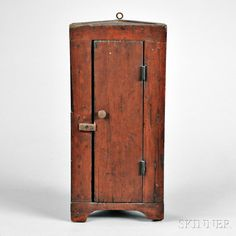 Red-painted Miniature Hanging Corner Cupboard, America, early 19th century, ht. 16, wd. 7 1/2, dp. 4 3/4 in.