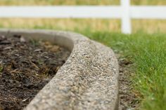 Garden edging with exposed aggregate.