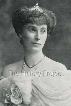 a full face image of Lady Alexander of Ballochmyle, wearing a delicate diamond with a heart-shaped central motif
