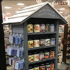 This Our-Own-Candle-Company Tall Rustic Shed Display is homespun in approach and appearance. As is to some extent the Our Own Candle Company name. Retail Fixtures, Store Fixtures, Our Own Candle Company, Rustic Shed, Candle Store, Slat Wall, Candle Companies, Merchandising Displays, Soy Candles