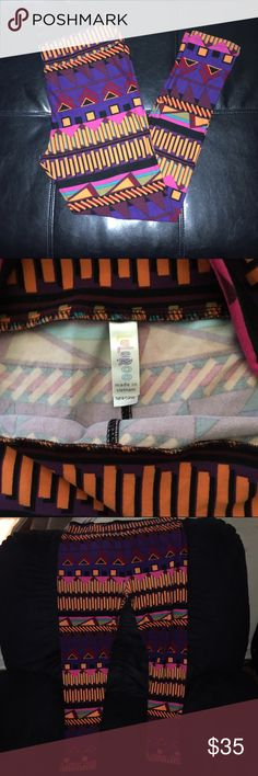 TC LuLaRoe BNWT Aztec/Abstract Leggings Brand new, never worn LLR fun and bright aztec/abstract print leggings. I've heard others refer to them as Saved by the Bell leggings due to their retro 80's style. Great shades of bright coral/apricot, purple, pink, Burgundy/wine, turquoise and black. The print on these lines up perfectly (unlike some other LLR patterns). EXTREMELY buttery soft, brand new in package, never worn. Check out my other listings to bundle and save 25% ! LuLaRoe Pants…