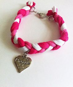 Pink and white braided friendship bracelet with by BeadingByJenn, $7.50 #jewelry #bracelet #friendshipbracelet #pink #heart #princess #braidedbracelet #braided #handmadejewelry #beadingbyjenn #accessories #etsy