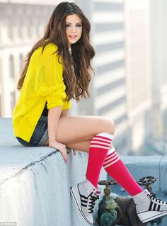 Selena Gomez makes trainers look sexy as she models her clothing collection for Adidas in urban shoot