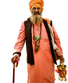 Hodges paid a local boy to help recruit subjects, all of whom were the mendicants who wander Pushkar asking for alms. The traditional dress of a sadhu tends to mimic the colors of fire, a purifying force: orange, yellow, red. Aside from his subjects' faces, Hodges was drawn to the beauty of their clothing, which emanated an effortless sense of style. 2014-08-08-pushkar4.jpg