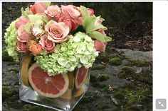 Mixing fruit and flowers to create colour and texture