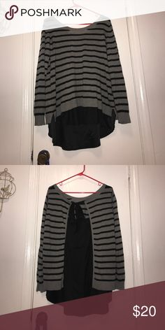 Torrid Sweater Worn one time is super cute and comfy had a cut now destabilize in the back too that can be tied tighter or looser if you need it too:) torrid Sweaters Crew & Scoop Necks