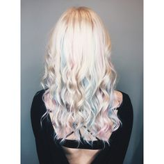 Beautiful pastel pink and blue hair with platinum blonde. Rainbow hair.