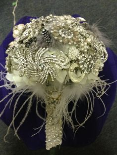 My Brooch Bouquet! Handmade by my sister, instead of bows on your gifts at your shower request brooches and they you can create a special bouquet with brooches from all of your closest friends and family.