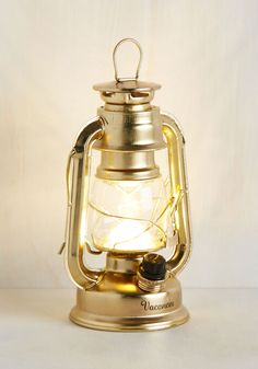 Try as I Light Lantern in Gold. We cant seem to find a single reason why one wouldnt want to have this LED lantern on hand! #gold #modcloth