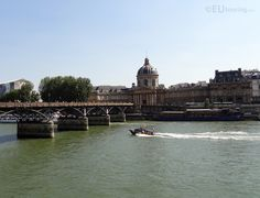 With a photo that faces towards the Institut de France you can also see the Pont des Arts which travels over the River Seine, along with a speed boat going by that we managed to capture.  See more www.eutouring.com/images_paris.html