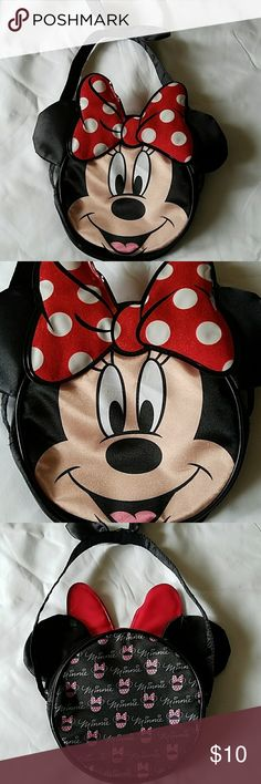 Adorable Minnie Mouse kids purse Adorable Minnie Mouse kids purse in excellent used condition. Round hand bag with Minnie's face in front. Very clean purse, no flaws. Measurements: 6 inches across and 9 inches tall including Minnie's ears, plus 8 inches for purse strap/handle. Disney Accessories Bags