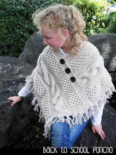 Knitted poncho with cables and rich texture, the perfect back to school jacket. Knitting pattern available on Craftsy, Etsy, and Ravelry. Girls Poncho, Baby Poncho, Poncho Knitting Patterns, Knitted Poncho, Chunky Yarn, Knitting For Kids, Crochet Designs, Back To School, Free Pattern