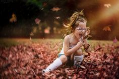 playing in the leaves.  photo