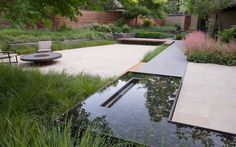 river pebble reflection pool with rill within || http://www.thuilot.com/residential/bi/