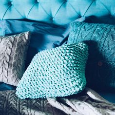 Cozy chunky and cable knit blue pillows from  Wannabe Decor @wannabedecor