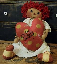 20 Primitive Raggedy     Her heart reads:    God Bless My Old Raggedy Heart