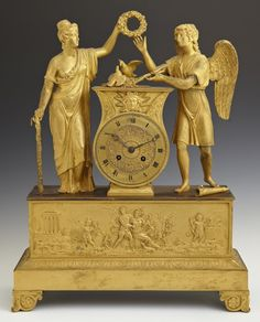 French Empire Gilt Bronze Mantel Clock, early 19th c., by Alexis Christophle, time and strike, with a silk thread suspension, the central drum clock flanked by an angel and a woman holding a wreath, on a base with a classical relief frieze of putti, cupid and a woman, above a sloping relief decorated band on a plinth base on four feet, H.- 18 in., W.- 14 in., D.- 15 in.