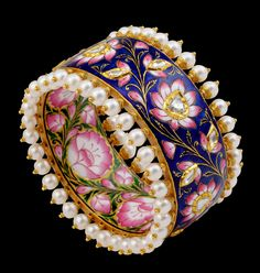 Sunita Shekhawat's blue and pink enamel bangle with lotus flowers. Note how it is decorated both inside and out.