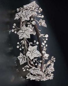 A fine 19th century diamond tiara, by Garrard Co., designed as a full circle of old-cut diamond ivy leaves, with diamond single-stone collet berries, mounted in silver and gold, the seven principal leaves detachable for brooch conversion, leaves circa 1860, the collets added circa 1900, diamonds in excess of 100 carats, in a red leather case, stamped R S Garrard Co.