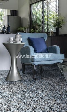 Alfa Centauri Collection, floor on marble Nero Marquinia decorated blue and silver by AKROS.