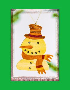Photograph by Jo Ann Tomaselli - Holiday Snowman Art Ornament with Green Fine Art Prints and Posters for Sale jo-ann-tomaselli.artistwebsites.com