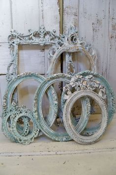 We love these wonderfully shabby ornate frames, with all the pictures in them, lining the walls