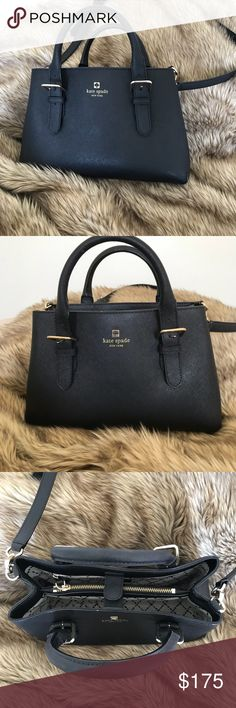 Kate Spade Purse Kate Spade Purse with optional cross body strap. It's a lot bigger than it looks in the pictures, I used it to hold all my work documents. It's in great condition looks brand new. If you would like dimensions just ask! kate spade Bags Crossbody Bags